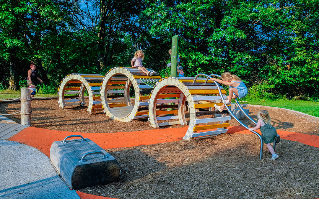 London Ontario natural playground caterpillar sculpture transfer bench accessible surface children at play