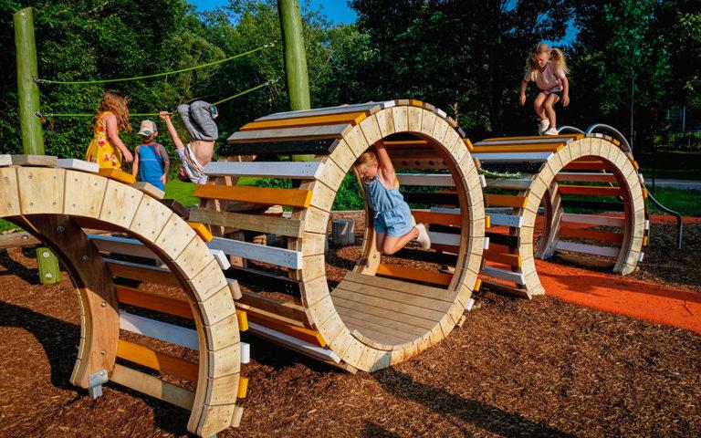 natural playground wood sculpture climbing swinging accessible caterpillar